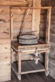 Old millstone in a house — Stock Photo