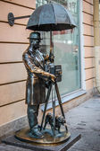 Sculpture of photographer with a dog — Foto Stock