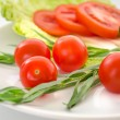 Fresh tomatoes, tarragon, onions on a plate — Stock Photo #61570067