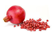 Cut the pomegranate with scattered grain top view isolated on white background — Stock Photo