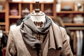 Mannequin in a jacket and scarf — Stock Photo