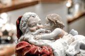 Santa Claus with kid figurine — Stock Photo