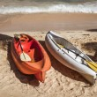 Two colorful kayaks on sand beach — Stock Photo #69972849