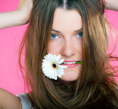 Square color image of young beautiful girl with flower in her mouth — Foto Stock