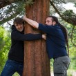 People hugging trees to support nature , environment concept — Stock Photo #61711023
