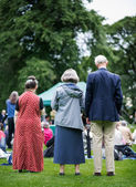 Older generation, seniors, enjoying an outdoors music, culture, community event, festival. — Stock Photo