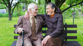 Cute 80 plus year old married couple posing for a portrait in their garden. Love forever concept. — Stock Photo
