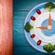 Ood clock with vegetables, Healthy food concept, on wooden table with copy space — Stock Photo #63419903