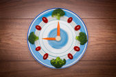 Ood clock with vegetables, Healthy food concept, on wooden table with copy space — Photo