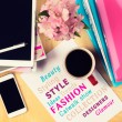 Office table with fashion magazines, digital tablet, smartphone and cup of coffee. View from above with copy space — Stock Photo #66875829