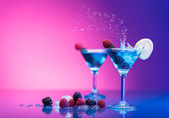 Colourful cocktails garnished with berries — Stock Photo