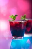 Raspberry and blackberry cocktail with mint garnish. Studio shot — Stock Photo