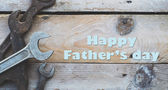 Fathers day concept, Various size spanners, wrenches on wooden background, colorised vintage feel — Stock Photo