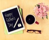 Table with Fathers day card on digital tablet. View from above — Zdjęcie stockowe