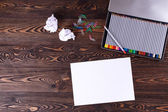 Colored pencils. Sheet of paper. The jammed paper. — Stock Photo