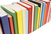 Neat row of colorful paperback books — Stock Photo