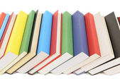 Leaning row of colorful books — Stock Photo