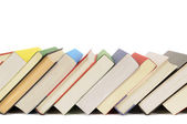 Slanted row of colorful books — Stock Photo