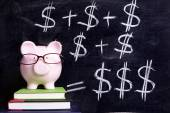 Piggy Bank with blackboard formula — Stockfoto