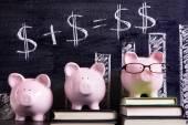 Piggy Banks with savings formula — Stock Photo