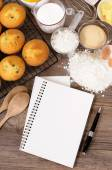 Fresh muffins with blank notebook — Stock Photo