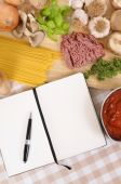 Cookbook with ingredients for spaghetti bolognese — Stock Photo