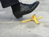 Businessman about to step on a banana skin — Stock Photo