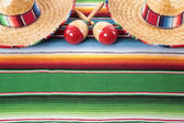 Mexican blanket with two sombreros — Stock Photo