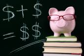 Piggy Bank with blackboard — Stock Photo