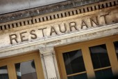 Old stone restaurant facade — Stock Photo