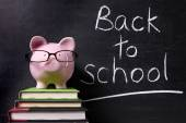 Piggy Bank with back to school message — Stock Photo