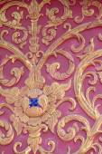Stucco wall burgundy color thai art — Stock Photo