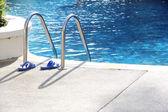 Sandal near the swimming pool ladder — Fotografia Stock