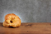 Croissant bakery on teakwood table — Stock Photo