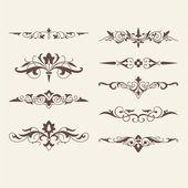 Curled calligraphic design elements — Stock Vector