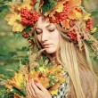 Young woman with autumn leaves in hand and fall yellow maple gar — Stock Photo #65102957