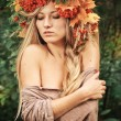 Young woman with autumn leaves in hand and fall yellow maple gar — Stock Photo #65105799
