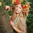 Young woman with autumn leaves in hand and fall yellow maple gar — Stock Photo #65105923