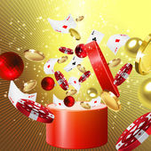 Christmas gift with glittering balls, casino  chips, cards and coins coming out of it — Stock Photo