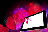 Love Hearts going out from a Tablet pc — Stock Photo