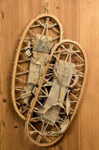 Old Snow Rackets on Wood Wall in a Mountain Cabin — Stock Photo