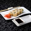 California rolls sushi with pickled ginger, vasabi and soy sauce in the plate — Stock Photo #61722791