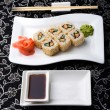 California rolls sushi with pickled ginger, vasabi and soy sauce in the plate — Stock Photo #61722797