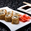 California rolls sushi with pickled ginger, vasabi and soy sauce in the plate — Stock Photo #61722811