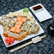 California rolls sushi with pickled ginger, vasabi and soy sauce in the plate — Stock Photo #61722833