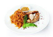 Restaurant food isolated - german sausages with braised sauerkra — Stock Photo
