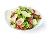 Restaurant food isolated - salad with fried bacon and parmesan — Stock Photo