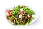 Restaurant food isolated - salad with ham jamon and mozzarella — Stock Photo