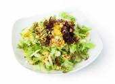 Restaurant food - vegetable salad with peanuts and orange — Stock Photo