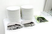Catering - stacks of plates and cutlery — Stock Photo